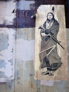 Steve Singer's Quanah Parker against a rusting metal door, Jersey City