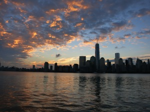 Sky changes as the sun rises over Lower Manhattan. Photo Credit: Adriana Rambay Fernandez